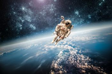 Fototapete - Astronaut im Weltall
